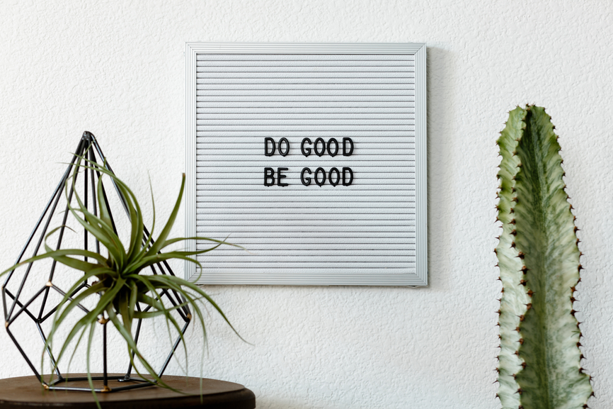 "A white board reads: ""Do Good, Be Good."""