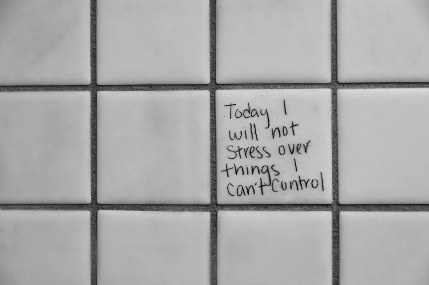 "Graffiti on a wall which reads: ""Today I will not stress over things I can't control."""