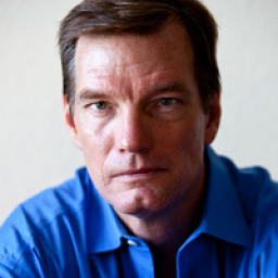 Image of a man in a blue collared shirt looking determined.
