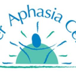 Image of the Adler Aphasia Center logo. The logo features the Adler Aphasia Center wording in a semi-circled shape around a graphic of a man super imposed by the sun.